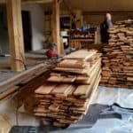 Piles of old wood planking for the interior