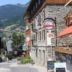 Summer street in Chalet Village, France