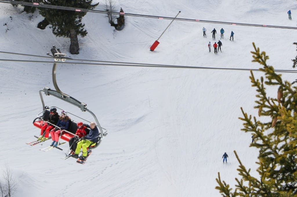 family sitting on chairlift