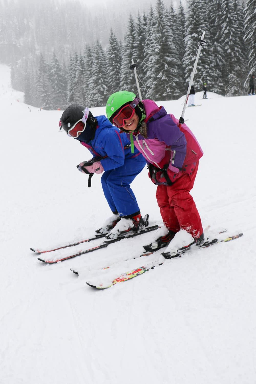 Children posing in ski race position