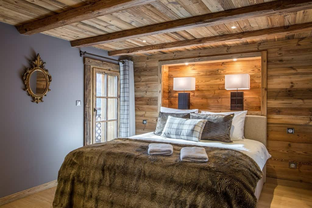 A bedroom inside our luxury catered ski chalet