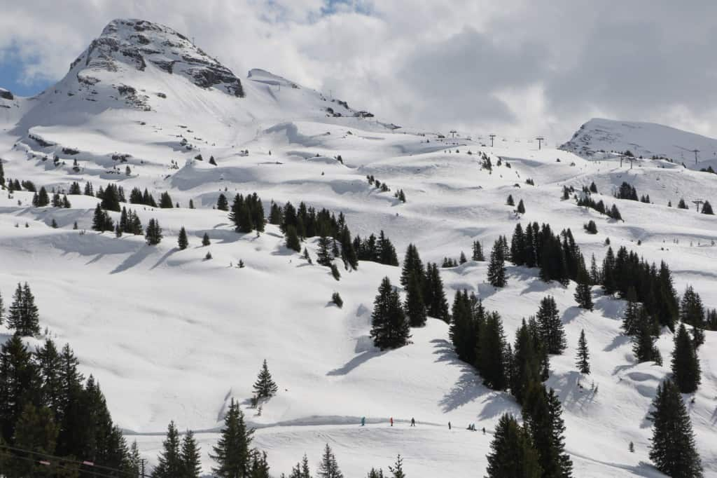 A mountain side view covered in snow