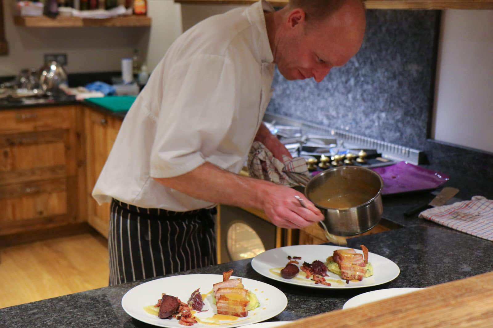 chef plating up dinner