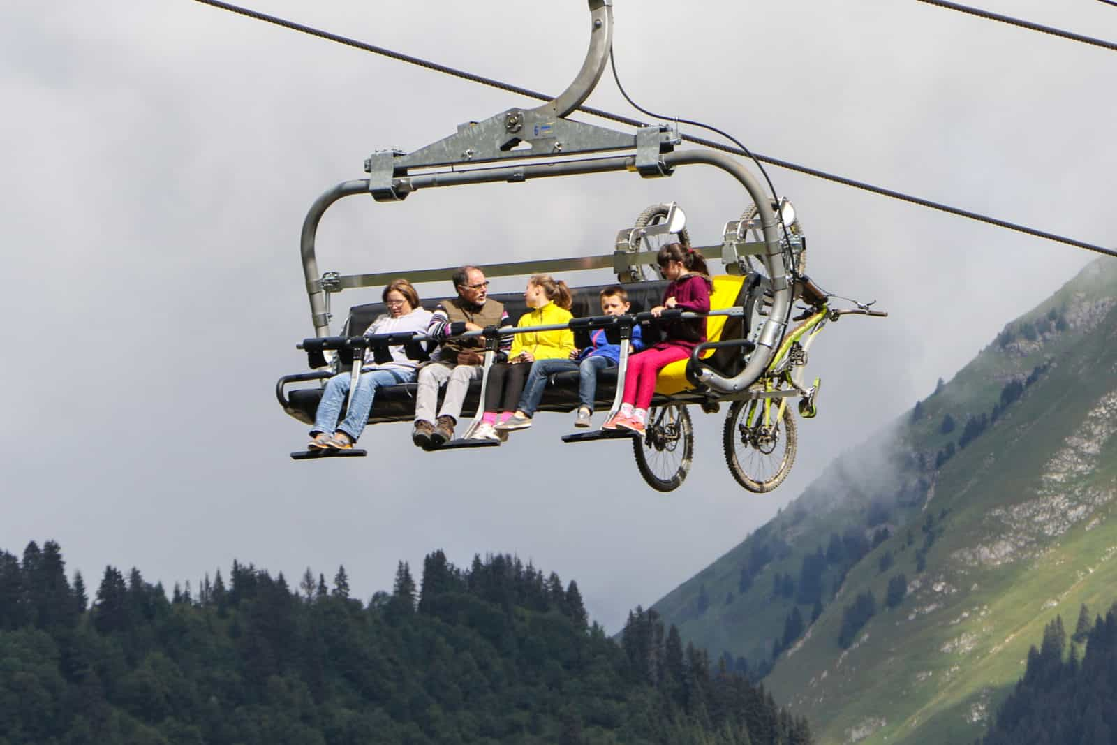 People and mountain bikes on a chairlift
