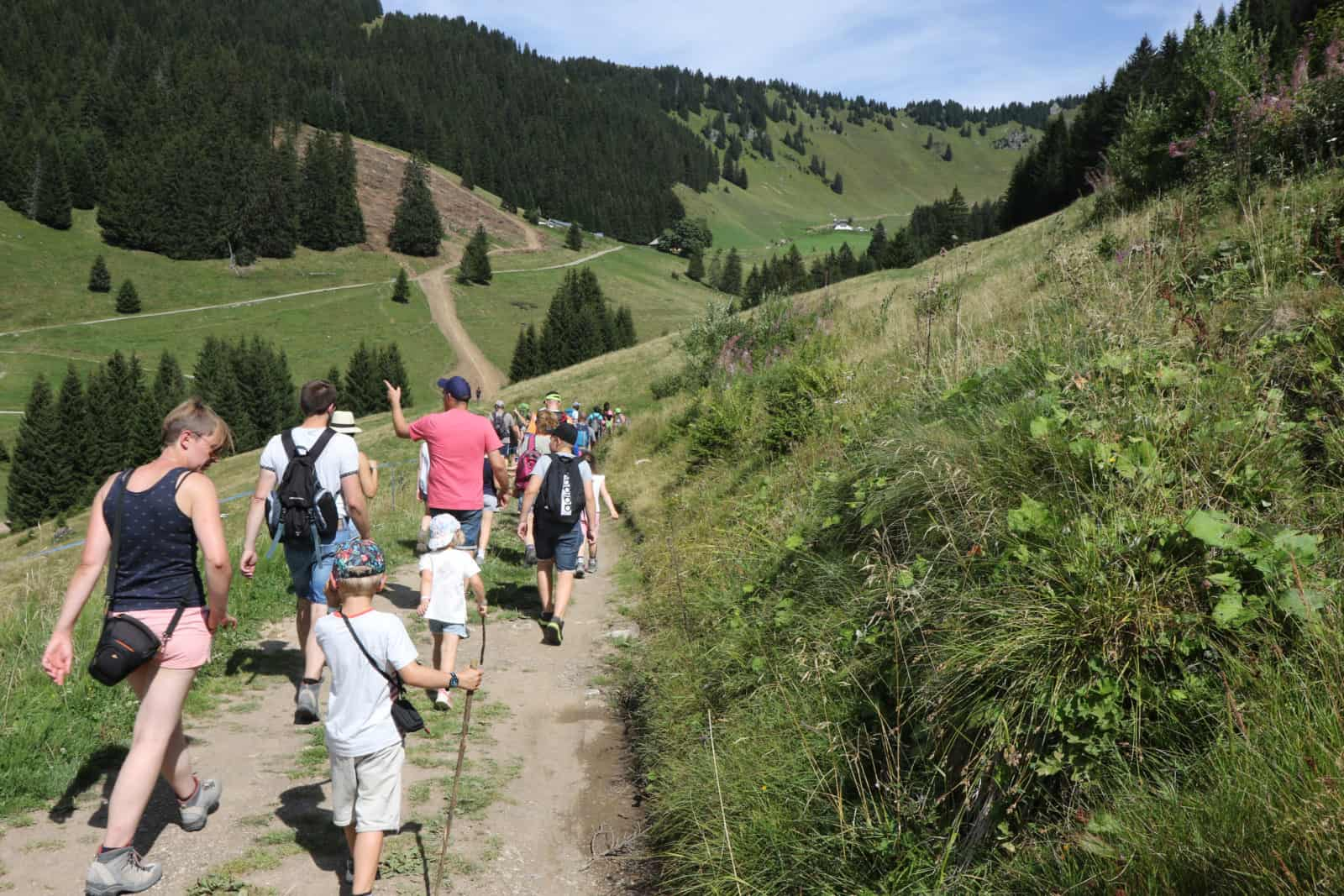 Family walking in the mountains of Chatel