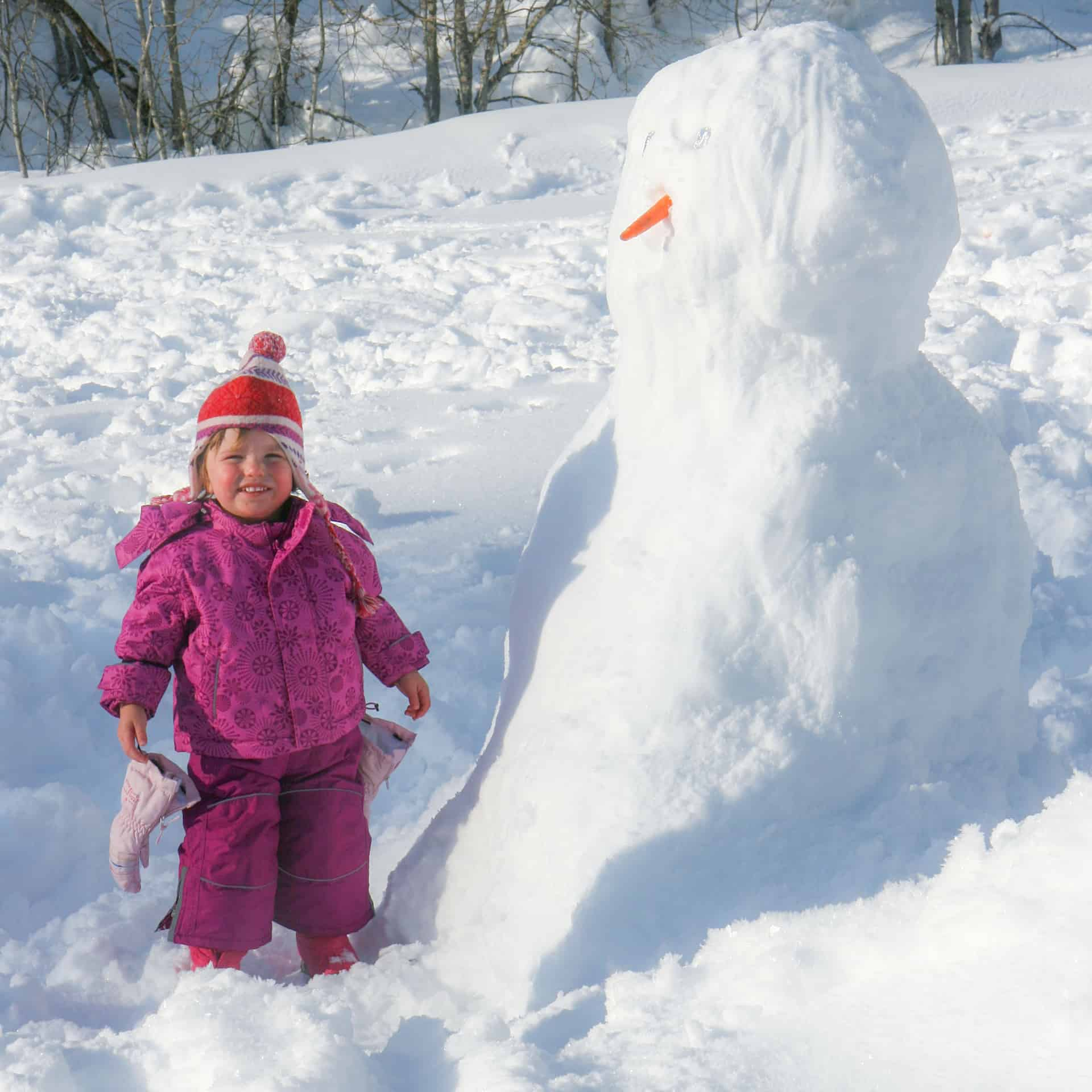 child building a snowman
