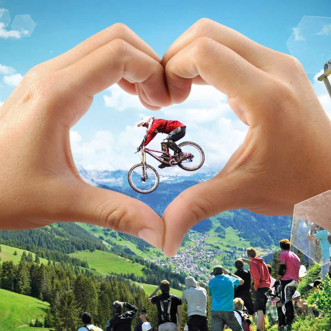 Châtel mountain bikers jumping in the portes du soleil