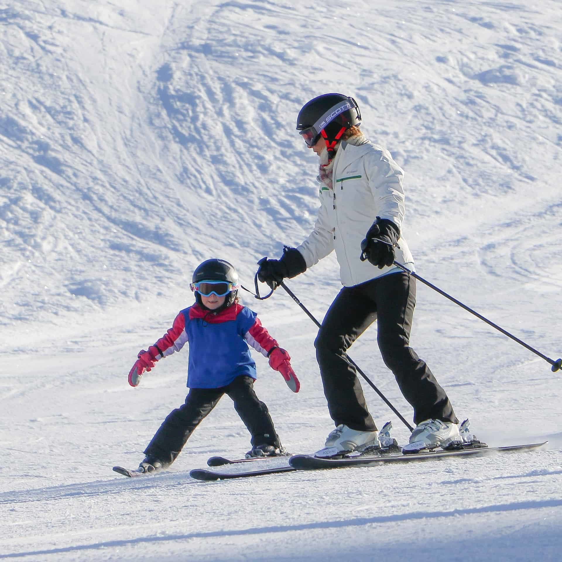 mother and child skiing